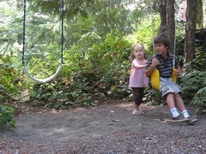 Brenna pushing Hayden on the swing
